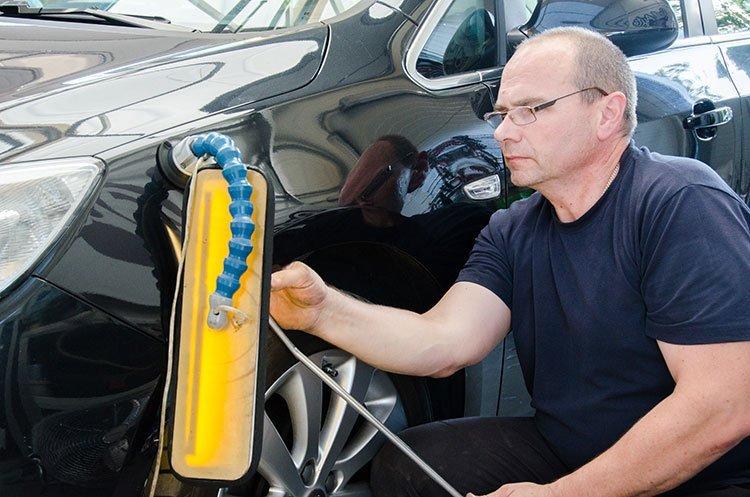 Paintless Dent Repair Man in The Works